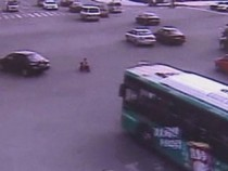 SHOCKING VIDEO: 3 Year Old Rides Bike Through Heavy Traffic