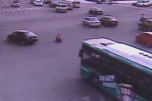 3 years old toddler crosses busy intersection
