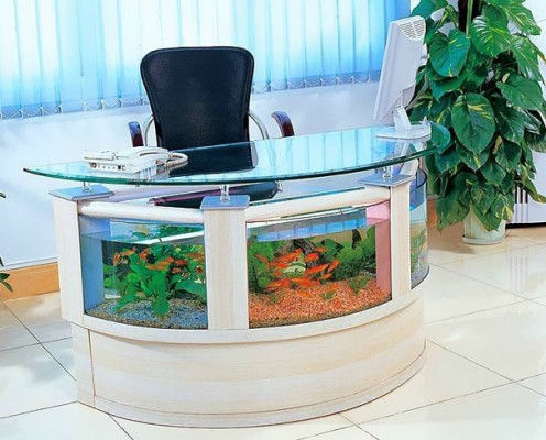 an office table with a built in aquarium