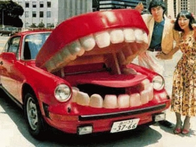 a porche 911 with giant teeth on the front