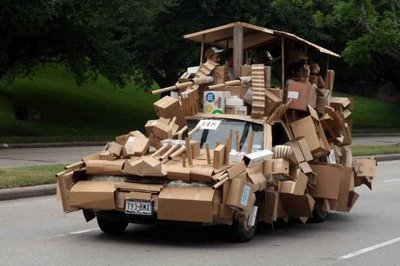 a car covered in cardboard for a crazy car display