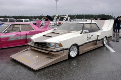 a crazy car with ridiculously too big diffusers