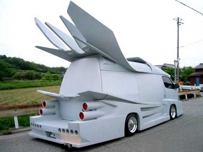 a strange crazy grey van