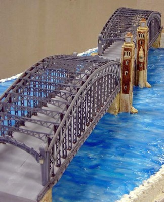 a cake resembling an irn bridge over a river