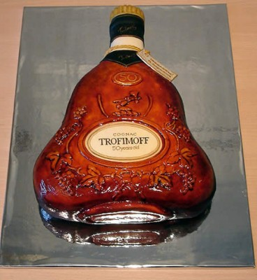 a cake shaped as a cognac bottle