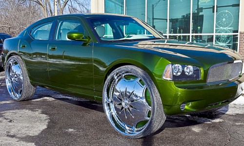 Dodge charger riding on 30 inch rims