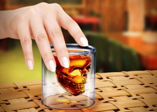 a shot glass in the shape of a skull