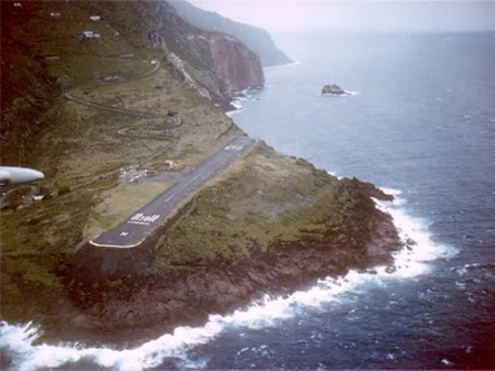 juancho e yrausquin airport on the side of a mountain