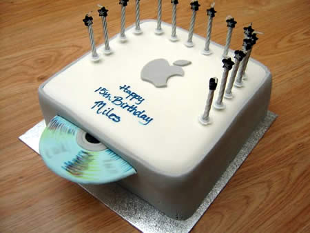 a cake shaped as a mac mini with a cd