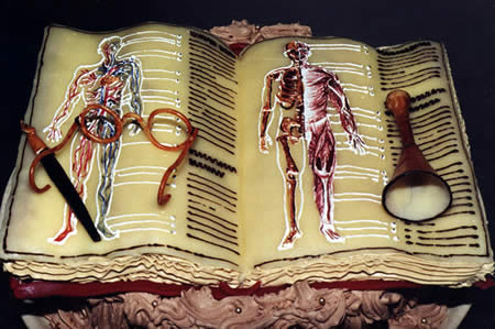 a cake shaped as a medical school book