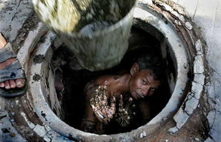 a guy cleaning sewers