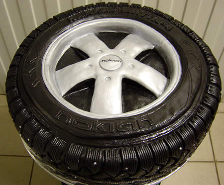 a cake shaped as a nokian car wheel with tire