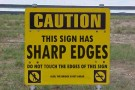 caution sharp edges sign