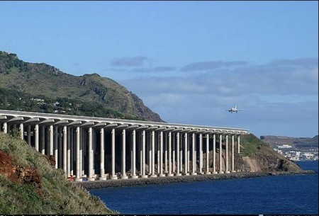an aircraft aproaching a runway built on a bridge