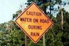wet road sign