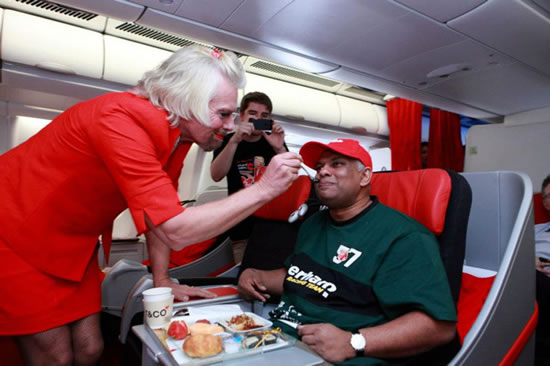 Richard Branson Dresses As Air Hostess After Loosing Bet 6