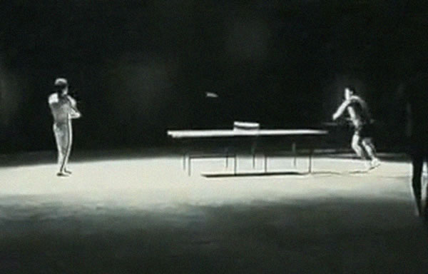 bruce lee playing table tennis with nunchucks