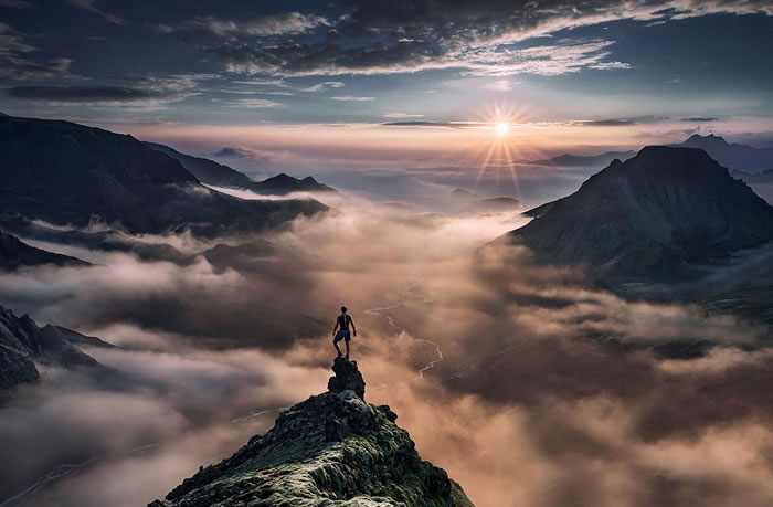 standing on the edge of the world