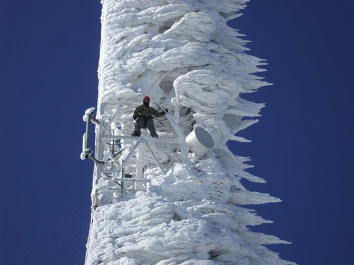 cell-phone-telecommunications-tower-covered-in-wind-blown-ice