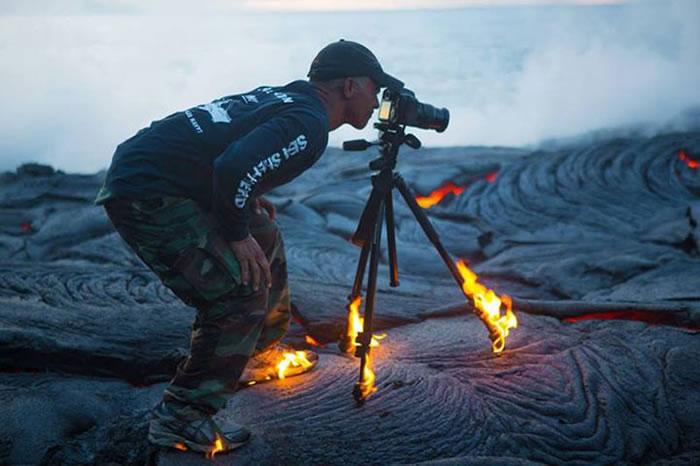 kawika-singson-standing-on-lava-shoes-tripod-on-fire