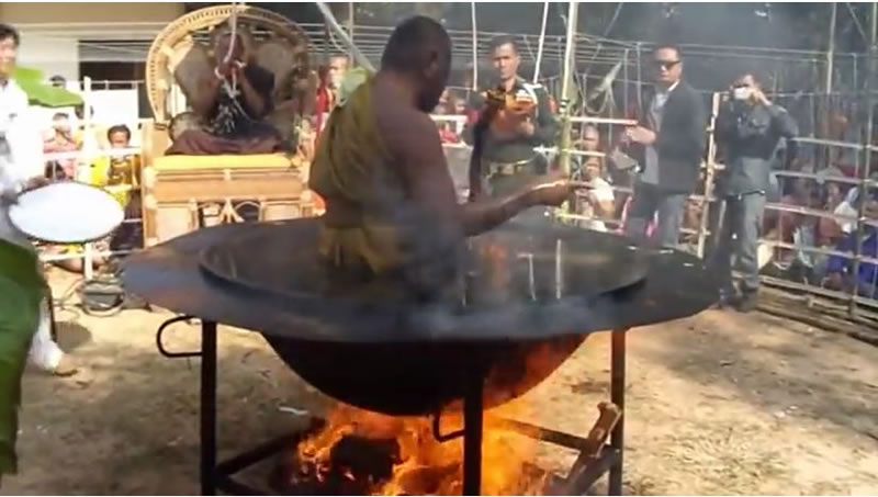 Thai Monk Practices His Meditation In Pot Of Boiling Water (1)