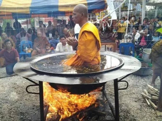 Thai Monk Practices His Meditation In Pot Of Boiling Water (2)