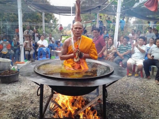 Thai Monk Practices His Meditation In Pot Of Boiling Water