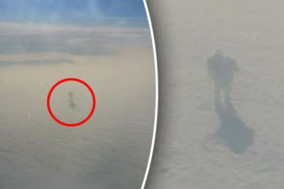 Passengers Aboard Plane Flight Spots Figure In Clouds