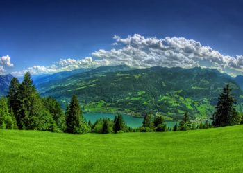 lush green lawn with beautiful mountains in the background